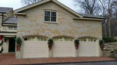 Custom handcrafted wood carriage house garage doors offered in many wood species. Carriage House Garage Doors, Wood Garage Doors, House Doors, Holiday Decorations, Seasonal Decor, Seeded, Custom Wood, Wood Species, Christmas Holidays