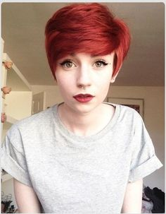 Short Pixie with a bold red color.