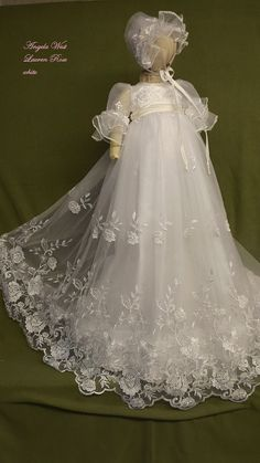 A romantic garden of roses are finely embroidered French net for this Victorian style gown. The flowers are accented with pearls and the waist