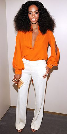 SOLANGE KNOWLES Silky orange top with slashes on the sleeves. Wide-leg white pants. Yep, it must be summer. Solange breaks out the seasonally-appropriate look when she joins her sister at the Chime for Change event in N.Y.C.