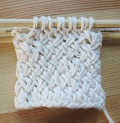 Learn how to work the super popular diagonal basketweave in the round - perfect for all kinds of cozy knitting projects. It's so much easier than it looks! #knittingprojects
