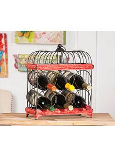 Red & Black Birdcage 6 Bottle Wine Rack from WineRacks.com for $79.00  Dimensions: 13w x 6.5d x 16.5h Capacity: 6 Bottles  Metal with rustic red painted accents.