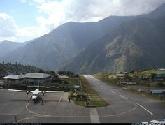 A busy day at Lukla Airport. Seen here is a takeoff of a Twin-Otter, with the next one ready to go. A Do-228 had to park on the runway because all parking spots were full. Due to bad weather on the previous days, there were a total of 42 flights on this day! Of interest: only pilots with over 7 years' experience are allowed to land here!  Yeti Airlines De Havilland Canada DHC-6-300 Twin Otter  Lukla - Tenzing-Hillary (LUA / VNLK) Nepal, October 11, 2005