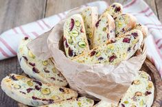 """Cranberry Pistachio Biscotti Recipe is one of the authentic biscuits originated from Italy. It also is known as """"Cattuccini"""" as the name means. Eggless Cookie Recipes, Eggless Desserts, Eggless Baking, Eggless Biscotti Recipe, Pistachio Biscotti, Tea Time Snacks, E Mc2, Orange Recipes, Breakfast Cake"""