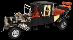 """The Munster Koach Built by George Barris for the classic TV show, the MUNSTER KOACH was created from three Model T bodies painted in black with a """"blood red"""" interior. We've released it for 2011 with the small additional details you've come to know from Auto World."""