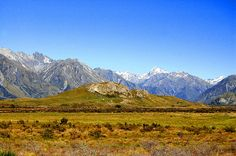 This is the place were Legolas & Co. rode to Edoras, the village on top of the hill in the Lord of the Rings movie. It's in the middle of nowhere, a long gravel road through the mountains on the South Island of New Zealand. New Zealand Tours, Legolas, South Island, Filming Locations, British Isles, Lord Of The Rings, Australia Travel, Dream Vacations, Places To See
