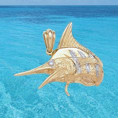 Marlin in 14k gold with diamond eye. (T155-PD).  www.skeletonfish.com
