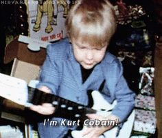 Kurt Cobain (K.C.) I find it interesting how K.C. from first guitar on, always played guitar as a left hander & when writing and painting etc.. he used his right hand for holding the writing/art tool. Not every person has one dominant hand and side of brain.