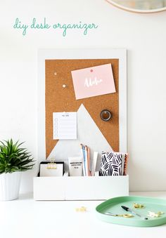 Get organized for spring with this pretty DIY desk organizer made from recycled wooden boxes. There's space for all your bits and bobs to be filed away and a pin board to stick up your inspirations and reminders.