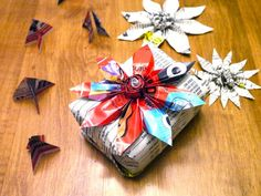 Christmas poinsettia bow for a package made out of junk mail (Wow, she gets really beautitful junk mail!) michele made me
