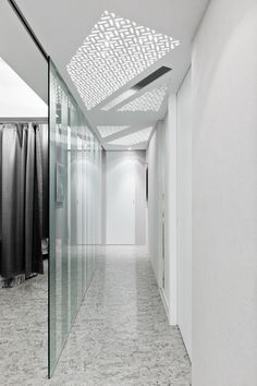 Luxurious Clinic Interior Design in Neutral Colors: Bright Clinic By ATELIERII Interior Glass Room Divider Marble Floor