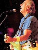 Jimmy Buffett - only partly for his music, and he's one of my faves. His attitude and perseverance inspire even more.