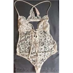 Victoria's Secret floral lace halter teddy S Sexy Victoria's Secret teddy! Features flirty floral lace pattern! Adjustable racerback straps.  Open back! Victorias secret Intimates & Sleepwear Chemises & Slips