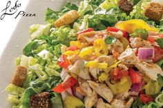 Ledo Pizza - Chicken Chop Salad - A chopped blend of chicken, red onion, tomatoes, banana peppers and basil, tossed in Lite Balsamic dressing atop crisp Romaine lettuce. Served with croutons and garnished with fresh basil and shredded Parmesan. 6.99