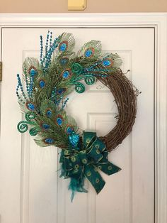 Peacock Grapevine Wreath, Christmas Peacock Wreath, Christmas Grapevine Wreath, Peacock Feather Wreath, Teal Christmas Wreath, Christmas Mantle Wreath This amazingly stunning Peacock Grapevine Wreath is a true show stopper! This would be simply stunning on your front door this