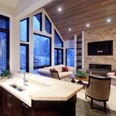 Onyx countertops, linear stacked slate fireplace, sand & finish wood ceiling, windows...fantastic!