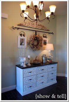 Refurbished dresser for entryway. I saw the woman who did this on the Nate Berkus Show. Saundra Kushnet..I think is her name. She has a blog <3