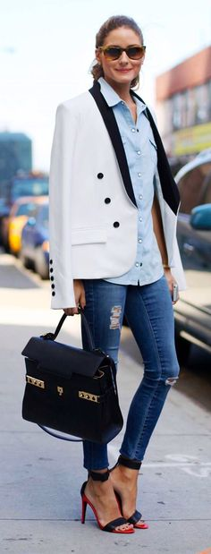 Girl wearing jeans & light blue collared button down shirt with white & black trim tuxedo jacket outfit