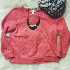 LOFT Cropped Coral Sweatshirt Such a beautiful color and pattern to take you into spring! The ribbing detailing allows this sweatshirt to be worn with jeans and sneakers or a statement necklace and heels! Gently used. Good condition. LOFT Sweaters Crew & Scoop Necks