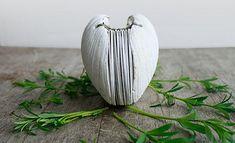 http://www.designsponge.com/2013/04/odelae-hand-stitched-journals.html#more-173246  http://assets4.designsponge.com/wp-content/uploads/2013/04/il_570xN.437746711_l56o.jpg