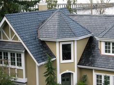 One of the major benefits of slate roofing lies in its natural aesthetics. Since slate comes in a wide variety of sizes, colors, and thicknesses, one can create a wide range of looks to enhance just about any architectural style. Roofing Tools, Roofing Options, Roofing Systems, Roofing Companies, Roofing Services, Roofing Contractors, Florida Apartments, Commercial Roofing, Residential Roofing