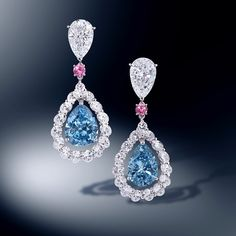 http://rubies.work/0391-sapphire-ring/ 0094-ruby-rings/ Moussaieff Jewellers. Natural fancy vivid blue diamond pear earrings with oval diamond surrounds, pink diamond accents and diamond pear tops.