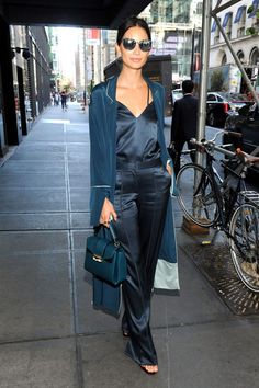 - Take the pajama trend for a spin with a matching satin cami-and-trousers combination styled with heels and a structured satchel.