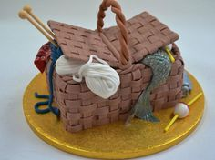 His and Her Hobbies combine in this clever Basket Cake by Cake Couture Marbella. Who'd think two different hobbies such as knitting and fishing could combine tastefully?
