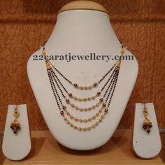 Jewellery Designs: 5 Step Black Beads Set Jhumkas