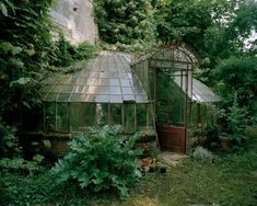 strange little battered glasshouse attached to chateau of Christian Louboutin, photos of Francois Helard