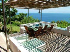 The dining area on the panoramic terrace of Villa Materano 1, close to Scopello and with private access to the last cove before the Zingaro nature reserve : the cove of Mazzo di Sciacca. http://www.dreamsicilyvillas.com/seaside-sicily-villas/materano-1/