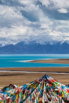 prayer flags and blue lake, Tibet