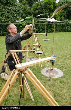 Artist  Jony Easterby makes adjustments to his piece, 'Rol mo wind horse', one of nine wind powered sound installations that make up Audible Forces at the Greenwich Fair 2013 Stock Photo
