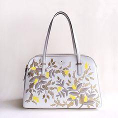 @Anna Totten Bond hand-painted a @Kate Mazur spade new york bag. so fabulous!