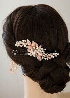 A classically styled, floral wedding hair comb with ivory freshwater pearls and marquise stones. This wave design bridal comb fits any wedding hair style! It is 4.75 inches long and 1.5 inches high on an alligator style pinch clip. It is available in rose gold or silver.