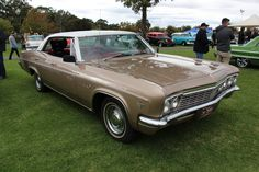 https://flic.kr/p/GpgB7W   1966 Chevrolet Impala 4 door Hardtop   The all new 1965 Chevrolet got a facelift in 1966, the front fenders thrusting forward and a revised grille. The tail lights now rectangular (still triple on Impala and double on Bel Air and Biscayne) Available in Sedan, 2 and 4 door Hardtop, Coupe, Convertible and Wagon.  Models; Biscayne, Bel Air, Impala (Fastback roofline and Super Sport option) and Caprice.(top of the line, included a two-door hardtop with a squared-off…