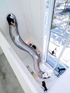 Dustin and I used to draw houses with slides like this! Except this one would have went outside, to a pool..
