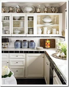 silver pieces above cupboards
