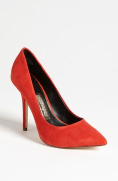 Red suede pumps.