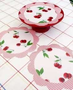 Cherry Oilcloth Doilies...I would love to have some of these!