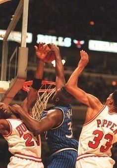 Shaq dunks over Michael Jordan and Scottie Pippen in 1995.