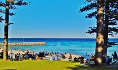 Cottesloe Beach - 12 Reasons to Visit Perth, Australia. The town of Cottesloe is also famous for its cafes, relaxed lifestyle, and it's Sunday sessions when locals throng to the beachfront pubs to watch the sun go down whilst enjoying a few drinks.