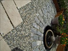 Patio Design Ideas: Pea gravel, stone and pavers mix well for a multi-textured patio surface.