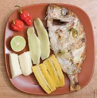 Angolan Food; Typical fish dinner with bananas and cassava.