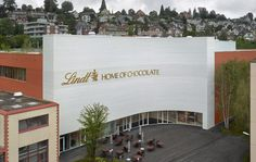 Architecture studio Christ & Gantenbein has completed a museum for chocolate brand Lindt alongside its headquarters in the Swiss town of Kilchberg on Lake Zurich. Red Brick Exteriors, History Of Chocolate, Lindt, Glazed Brick, Lake Zurich, Green Facade, Spiral Staircase, Christen, Atrium