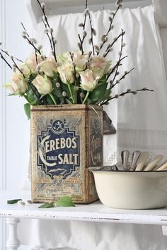 vintage can with flowers
