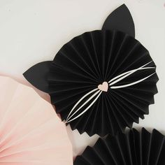 Follow the Kitty Kat party trend with this DIY cat paper fan. Kitty Kat party decorations inspiration to compliment to the Bee Box Parties Kitty Kat Collection.