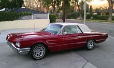 1965 Ford Thunderbird My Dad loved this car.(His was dark green with a soft shell top, not a convertable.) It had seat belts & bucket seats!