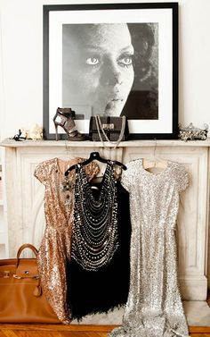 Add sparkle to any unused fireplace mantel by using favorite clothes as decorative pieces