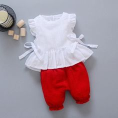 New Style 2017 Summer Baby Girls Clothes Sets Lace T Shirt Shorts 2 Pcs Infant Suits Comfortable Cotton Kids Casual SuitsGeorgia- Solid color two piece set. White sleeveless ruffle top with bow tie sides and layered lace ruffle bottom. Kids Dress Wear, Toddler Girl Dresses, Little Girl Dresses, Girls Wear, Baby Dress Design, Baby Girl Dress Patterns, Baby Frocks Designs, Kids Frocks Design, Girl Sleeves